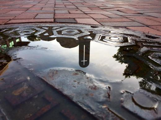 reflection of chapel in water